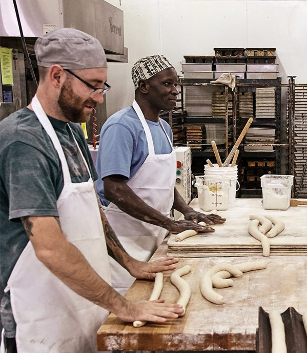 Guys Rolling Dough at the Bakehouse
