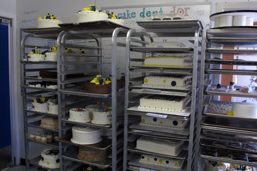 Our speed racks on Friday filled with cakes of all sorts of flavors like chocolate, buttermilk, and Hummingbird.