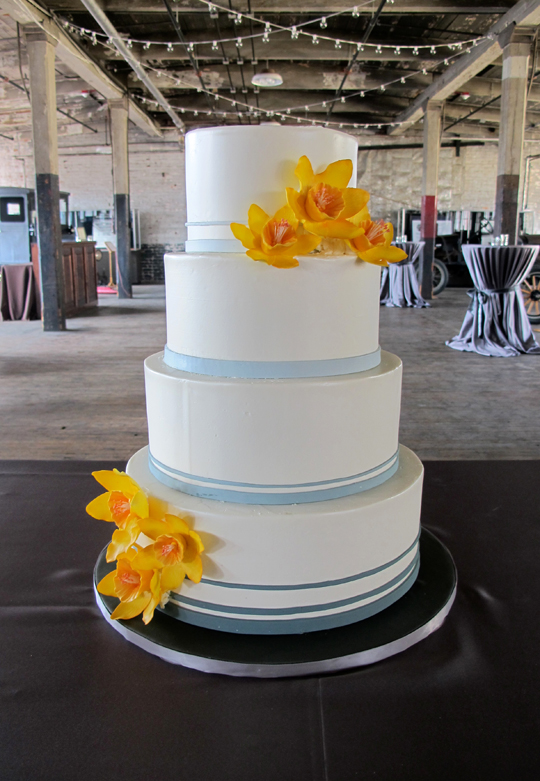 Gray ombré bands and gum paste daffodils.  Reception at the Ford Piquette Plant.